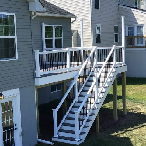 newly installed deck with white vinyl rails